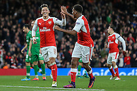 Mesut Ozil of Arsenal (left) celebrates scoring his third goal against Ludogorets Razgrad to make it 6-0 during the UEFA Champions League match between Arsenal and PFC Ludogorets Razgrad at the Emirates Stadium, London, England on 19 October 2016. Photo by David Horn / PRiME Media Images.