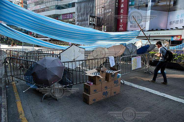 A barricade erected by the 'Occupy Central ' movement which is organising events of civil disobedience to protest against the Chinese government's electoral policy for Hong Kong. The umbrella has come to be the symbol of Hong Kong's anti government protests. Hong Kong was supposed to be having direct elections for the post of chief executive by 2017 but the government in Beijing has said that the election will only be from a list of pre-approved candidates.