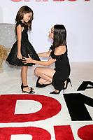 Ariana Greenblatt, Mila Kunis<br /> at &quot;A Bad Mom's Christmas&quot; Premiere, Village Theater, Westwood, CA 10-30-17<br /> David Edwards/DailyCeleb.com 818-249-4998