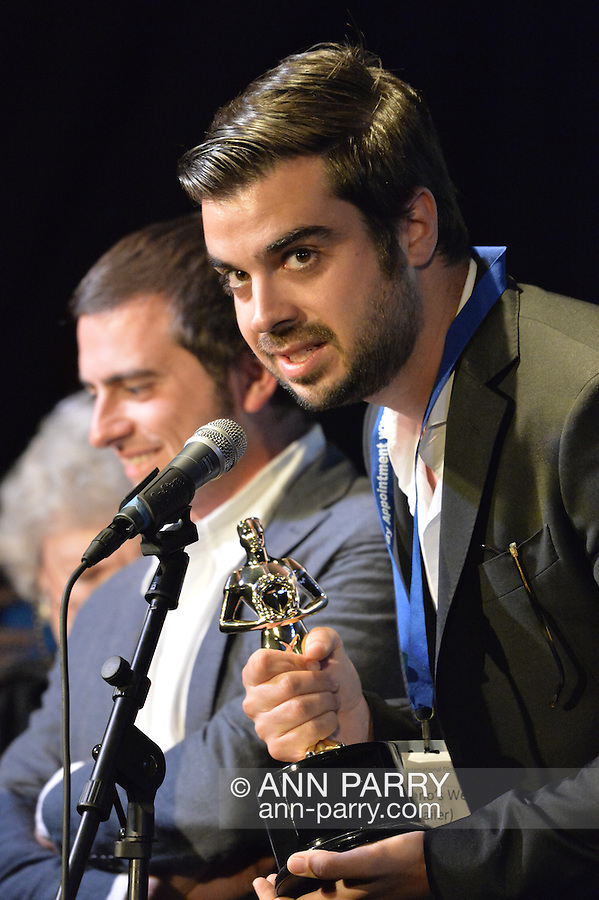 """Bellmore, New York, USA. July 21, 2016.  Winning Trailer is Italian film """"Giuliano's Web - La Teladi Giuliano"""" from Bologna, Italy, by Director Allesandro Amanta, Producer Enrico Rondinelli, and Writers Giuliano Giunta, Enrico Rondinelli and Alessandro Amante, accepting the trophy at the19th Annual Long Island International Film Expo Awards Ceremony, LIIFE 2016, held at the historic Bellmore Movies. A. LIIFE was called one of the 25 Coolest Film Festivals in the World by MovieMaker Magazine."""