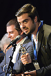 "Bellmore, New York, USA. July 21, 2016.  Winning Trailer is Italian film ""Giuliano's Web - La Teladi Giuliano"" from Bologna, Italy, by Director Allesandro Amanta, Producer Enrico Rondinelli, and Writers Giuliano Giunta, Enrico Rondinelli and Alessandro Amante, accepting the trophy at the19th Annual Long Island International Film Expo Awards Ceremony, LIIFE 2016, held at the historic Bellmore Movies. A. LIIFE was called one of the 25 Coolest Film Festivals in the World by MovieMaker Magazine."