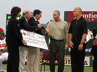 August 29, 2003:  Cal Ripken Jr. and his brother Billy Ripken accept a donation as Cal is inducted into the Rochester Red Wings Hall of Fame before an International League game at Frontier Field in Rochester, NY.  Photo by:  Mike Janes/Four Seam Images