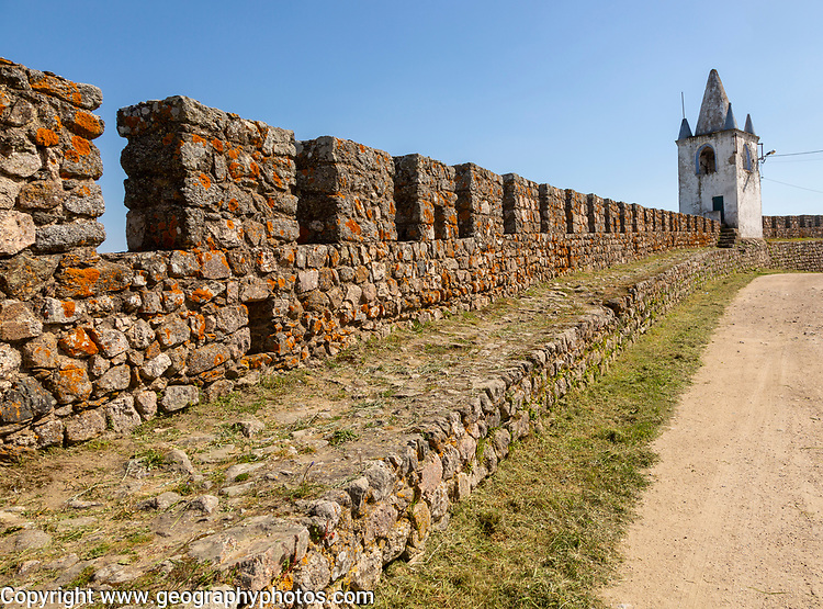 Battlements stone ramparts and watch tower in historic castle ruins at Arraiolos, Alentejo, Portugal, southern Europe - also known as Paço dos Alcaides built in 14th century