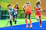 Eunbi Cheon #13 of Korea carries the ball while \NED17 and Maria Verschoor #11 of Netherlands cover during Netherlands vs Korea in a Pool A game at the Rio 2016 Olympics at the Olympic Hockey Centre in Rio de Janeiro, Brazil.