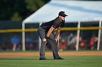 Umpire Adam Clark handles the calls on the bases during the Appalachian League game between the Danville Braves and the Burlington Royals at Burlington Athletic Stadium on August 9, 2019 in Burlington, North Carolina. The Royals defeated the Braves 6-0. (Brian Westerholt/Four Seam Images)
