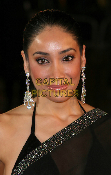"SOFIA HAYAT .Attending the European Film Premiere of ""Defiance"" at  Odeon Leicester Square, London, England, January 6th 2009..portrait headshot  black one shoulder sari sheer halterneck bikini top earrings dangly hair up diamante .CAP/JIL.©Jill Mayhew/Capital Pictures"