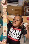 Education Preschool 3-4 year olds boy building block tower taller than he is