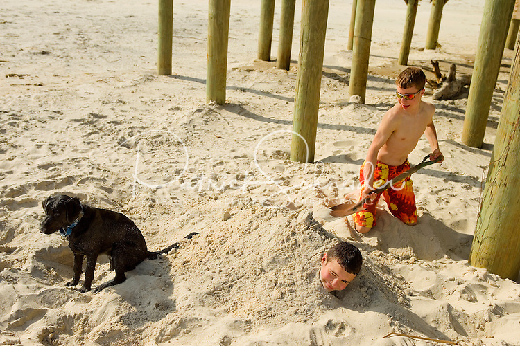 A boy plays on the beaches of Dauphin Island, Alabama, a barrier island located three miles south of the mouth of Mobile Bay in the Gulf of Mexico. This island, which is approximately 14 miles long and less than two miles wide, appears to have fully recovered from the impact of Hurricane Katrina (2005) and the BP Deepwater Horizon Oil Spill in 2010. Both events greatly reduced tourism income (fewer people came to the island) and local business owners say many establishments went out of business. Today they say they're looking forward to a rebounding tourism business.