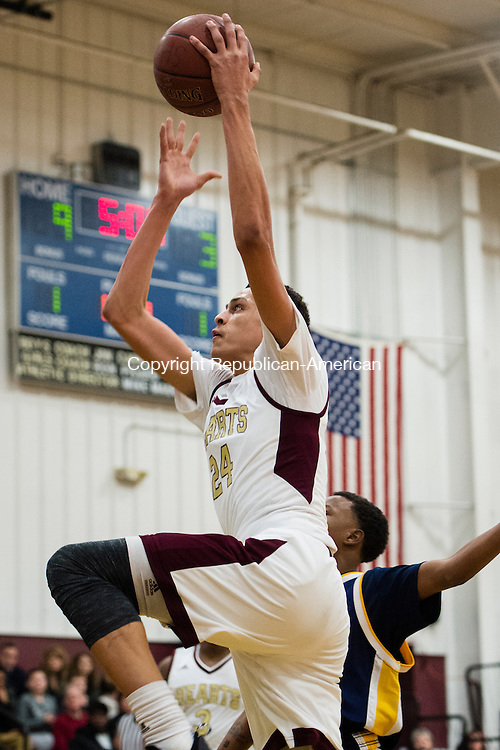 WATERBURY, CT- 8 January 2015-010816EC06-    Sacred Heart's Tyrn Flowers takes it to the hoop against Kennedy Friday night. The Hearts defeated the Eagles in front of a sold out crowd, 96-49. Erin Covey Republican-American