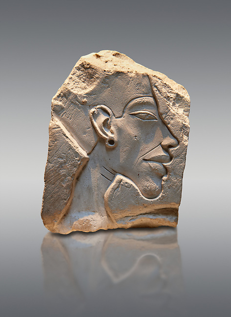Ancient Egyptian relief portrait of King Akhenaten from Amarna. 18th Dynasty 1340 BC . Neues Museum Berlin Cat No: AM 14512.