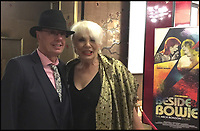 BNPS.co.uk (01202 558833)<br /> Pic: DavidStopps/BNPS<br /> <br /> David Stopps who launched the campaign pictured with Angie Bowie at the premiere of the Jon Brewer film &lsquo;Beside Bowie - The Mick Ronson Story&rsquo;.<br /> <br /> The return of the Thin White Duke...The statue will also include a lifesize Ziggy Stardust attached to the suited Bowie of a later era.<br /> <br /> The world's first statue of David Bowie is taking shape in sculpter Andrew Sinclair's Devon studio.<br /> <br /> Ever since the music legend's death in January 2016 there has been a clamour for a fitting tribute of Bowie to be made.<br /> <br /> While his birthplace of Brixton, south London, has been cited as the most likely location for one it is actually Aylesbury in Buckinghamshire that will lay claim to having the very first statue of him.<br /> <br /> The market town was where Bowie played an experimental gig in 1971 to see if had the confidence to perform live and then a year later where his alter-ego of Ziggy Stardust was born.<br /> <br /> One half of the statue has been completed by artist Andrew Sinclair. It depicts a handsome Bowie in his 'Blue Suit' period in the 1990s.