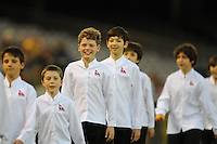 MELBOURNE, AUSTRALIA - OCTOBER 14: Members of the Australian Boys Choir leave the field in a AFC Asian Cup 2011 match between Australia and Oman at Etihad Stadium on October 14, 2009 in Melbourne, Australia. Photo Sydney Low www.syd-low.com