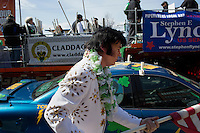 An Elvis impersonator gets an American flag ready before marching in the 2013 annual St. Patrick's Day Parade in South Boston, Boston, Massachusetts, USA.