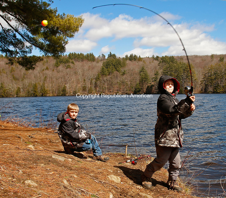 Torrington, CT 040817MK02 Eight year old Michael Maccalous casts his line as his twin brother Nate looks on while they fish Stillwater pond in the Drakeville section of Torrington Saturday afternoon.  Saturday was the opening day of trout season and traditional first day of fishing in Connecticut. Michael Kabelka / Republican-American