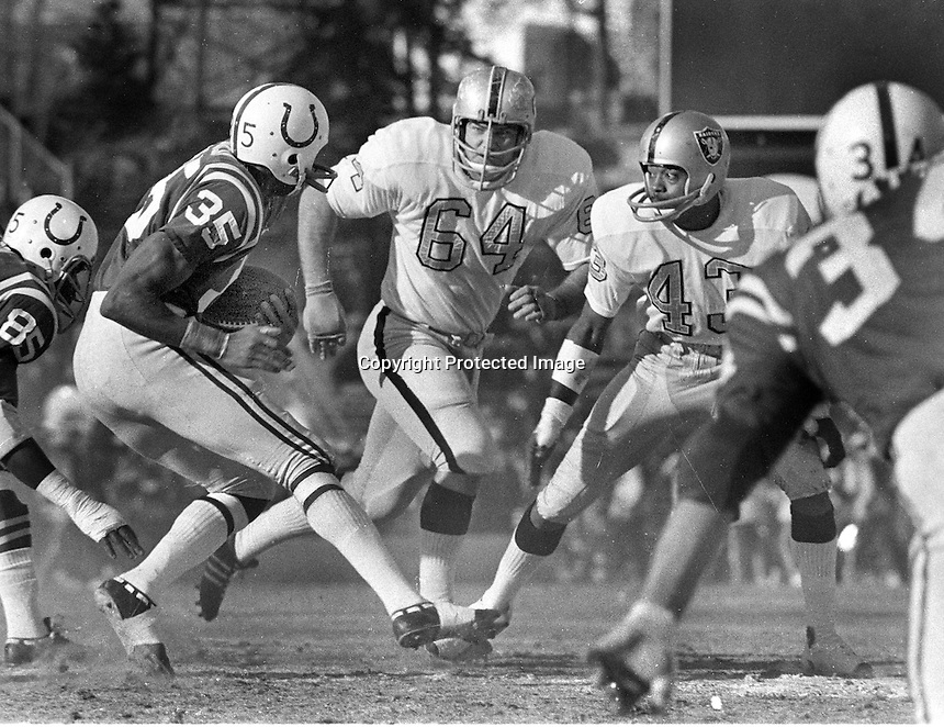 Oakland Raidersvs. Baltimore Colts, 1971 AFC playoff game in Balltimore.Colts Jim Duncan  #64 George Buehler, and #43 George Atkinson.. (photo/Ron Riesterer)