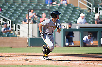 Surprise Saguaros left fielder Bryan Reynolds (10), of the Pittsburgh Pirates organization, starts down the first base line during an Arizona Fall League game against the Salt River Rafters at Salt River Fields at Talking Stick on November 5, 2018 in Scottsdale, Arizona. Salt River defeated Surprise 4-3 . (Zachary Lucy/Four Seam Images)