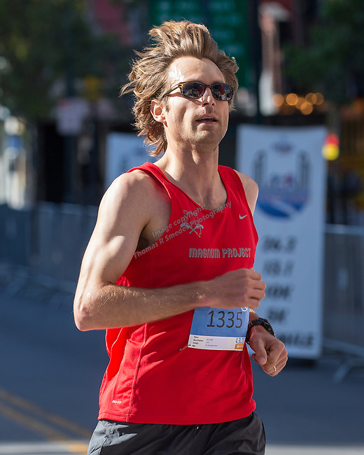 Zack Yeager crosses the finish line of the 5K run during the Downtown River Run on Sunday, April 30, 2017 in Reno, Nevada.  Yeager won the 5K race.