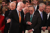 U.S. Senate Majority Whip John Cornyn and Senate Minority Leader Chuck Schumer talk while Senator Orrin Hatch (L-Rear) looks on as they attend ceremonies for the late former U.S. President George H.W. Bush inside the U.S. Capitol rotunda in Washington, D.C., U.S., December 3, 2018. <br /> CAP/MPI/RS<br /> &copy;RS/MPI/Capital Pictures