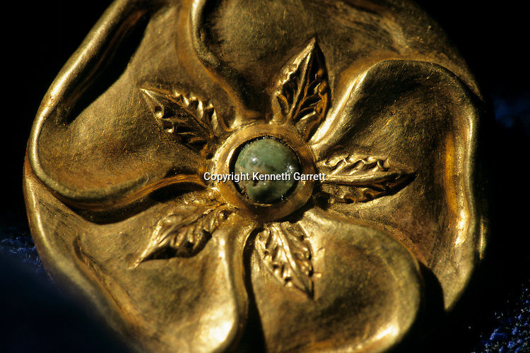Gold artifact from Tillya Tepe find,  six tombs of Bactrian nomads; Discovered in 1978 by Soviet archaeologist; Thought lost but discovered in 2003 in Afghan National Bank Vault, at the Presidential Palace; saved from the  Mujahadein and Taliban; Elements of  Greek, Indian, Asian culture.