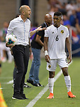 USA head coach Greg Berhalter talks about a foul with an official as Kevin Galvan (6) of Panama waits to take a throw in during their Gold Cup match on June 26, 2019 at Children's Mercy Park in Kansas City, KS.<br /> Tim VIZER/AFP