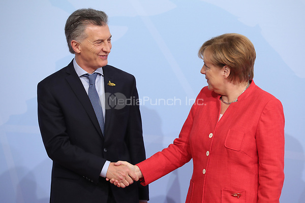 German chancellor Angela Merkel greets the Argentinian president Mauricio Macri at the G20 summit in Hamburg, Germany, 7 July 2017. The heads of the governments of the G20 group of countries are meeting in Hamburg on the 7-8 July 2017. Photo: Michael Kappeler/dpa /MediaPunch ***FOR USA ONLY***