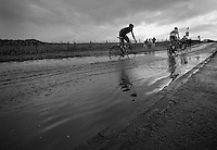 through the puddle<br /> <br /> 2013 Tour of Britain<br /> stage 1: Peebles - Drumlanrig Castle, 209km