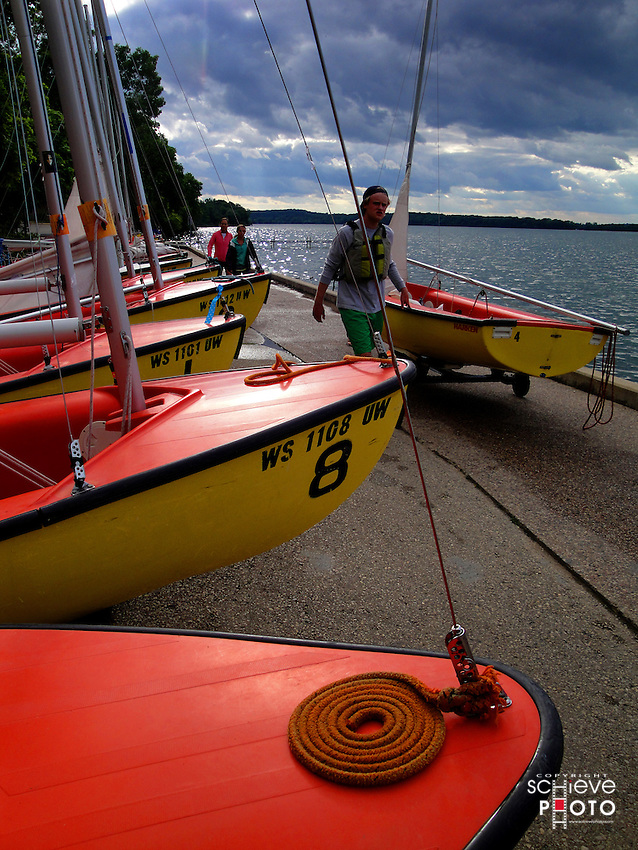 A crew prepares a sailboat for launch onto Lake Mendota on the University of Wisconsin-Madison campus.