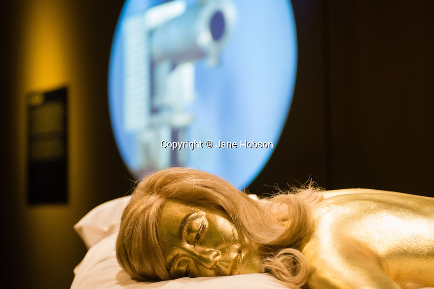 London, UK. 04.07.2012. Designing 007: fifty Years of Style exhibiton opens at The Barbican. Picture shows: Jill Masterton's (played by Shirley Eaton) gold body, recreating a scene from Goldfinger. Photo credit: © Jane Hobson.