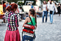 Girls with accordion in the street of Athens, Greece