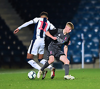 West Bromwich Albion U18's Morgan Rogers is tackled by  Lincoln City U18's Josh Woodcock<br /> <br /> Photographer Andrew Vaughan/CameraSport<br /> <br /> FA Youth Cup Round Three - West Bromwich Albion U18 v Lincoln City U18 - Tuesday 11th December 2018 - The Hawthorns - West Bromwich<br />  <br /> World Copyright &copy; 2018 CameraSport. All rights reserved. 43 Linden Ave. Countesthorpe. Leicester. England. LE8 5PG - Tel: +44 (0) 116 277 4147 - admin@camerasport.com - www.camerasport.com
