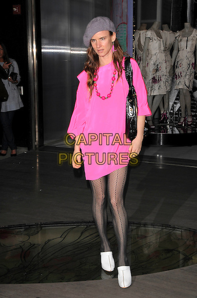 """JULIETTE LEWIS.Prada's Private Screening of the new Animated Short Fil """"Trembled Blossoms"""" held at Prafa Beverly Hills Epicenter in Beverly Hills, California, USA..March 19th, 2008.full length pink fluorescent dress necklace black tights pattern fishnet bag purse white shoes grey gray beret hat .CAP/DVS.©Debbie VanStory/Capital Pictures."""