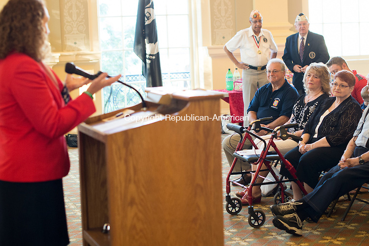 WATERBURY, CT - 26 August 2015-082615EC05-- The family of Vincent J. Didominzio, Sr., a WWII veteran, sits in on a Congressional medal presentation at Waterbury City Hall Wednesday night. DiDominzio, Sr. posthumously received the Bronze Star, the Purple Heart, the Good Conduct Medal and the American Campaign Medal from Congresswoman Elizabeth Esty (seen far left). DiDominzio's son, Vincent DiDominzio, Jr., took the medals on his father's behalf. Erin Covey Republican-American.