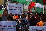 Palestinians hold banners during a protest against the worsening crisis of power outages in front of Gaza's power plant in Nuseirat in the center of Gaza strip, on June 21, 2017. Egypt began to deliver a million litres of fuel to Gaza, temporarily easing a crisis that has left the Palestinian enclave's two million residents with only a few hours of electricity per day. Photo by Yasser Qudih