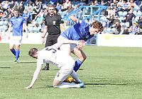 Michael Bolochoweckyj tackling Ian McGrath in the SPFL Ladbrokes Championship Play Off semi final match between Queen of the South and Montrose at Palmerston Park, Dumfries on  11.5.19.