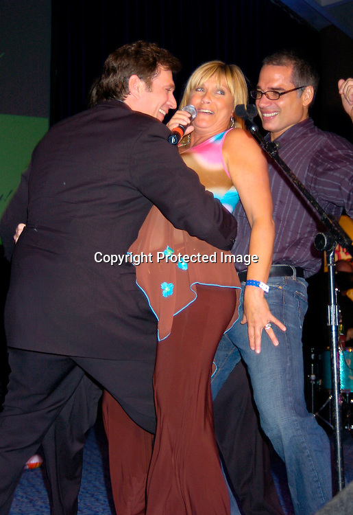Frank Dicopoulos, Tom Pelphrey and Kim Zimmer singing and George Alvarez ..at the 10th Annual Daytime Television Salutes St. Jude Children's Research Hospital Benefit on October 8, 2004 at the Marriott Marquis Hotel in New York City...Photo by Robin Platzer, Twin Images