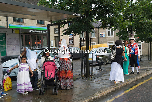 Uppermill, Saddleworth, Yorkshire Uk. Ethiopian family  meet a Saddleworth Morris man. Multicultural England. The Ethiopian family have lived in the area for 10 yrs.