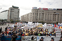ROMANIA / Bucharest / 19 May 2010 /  Tens of thousands of public sector workers protest in piata Victoriei against President Traian Basescu's plans to cut wages by 25% and pensions by 15%. Romania's economy shrunk by more than 7% in 2009 and it required an IMF loan in order to pay state wages. To qualify for the next part of the 20 billion Euro loan, Basescu says new austerity measures are required. © Davin Ellicson / Anzenberger