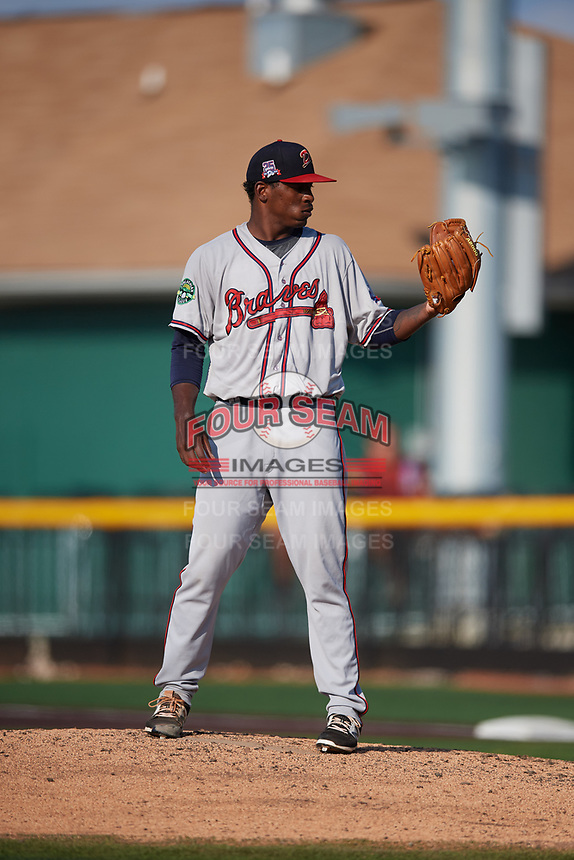 Danville Braves starting pitcher Jose Montilla (45) looks in for the sign during a game against the Johnson City Cardinals on July 29, 2018 at TVA Credit Union Ballpark in Johnson City, Tennessee.  Johnson City defeated Danville 8-1.  (Mike Janes/Four Seam Images)