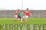 Declan Bambury of Beale gets the ball past Flor McAuliffe of Brosna last Sunday in Ballybunnion.