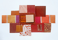 A collection of fabric swatches illustrating the colour range from cranberry to rhubarb