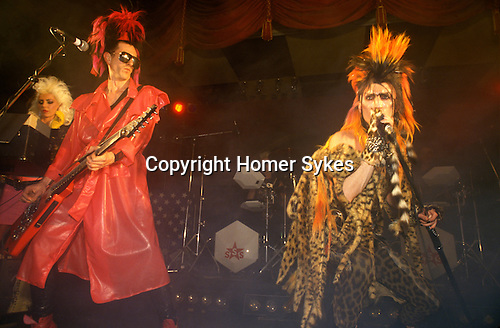 Sigue Sigue Sputnik  1980s New Wave band. David James, ( in red ) and Martin Degville vocals. Jane Farrimond keyboard. Newcastle upon Tyne. UK