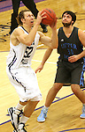 SIOUX FALLS, SD - DECEMBER 5:  Bryan Kielpinski #52 from the University of Sioux Falls looks to the basket past Josh Weeber #30 from Upper Iowa in the second half of their game Friday night at the Stewart Center.  (Photo by Dave Eggen/inertia)