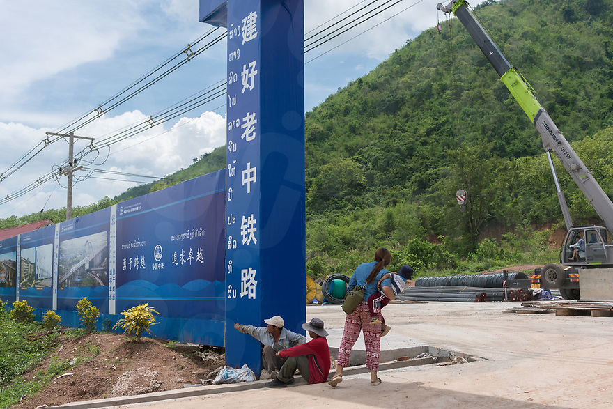 """May 15, 2017 - Luang Prabang (Laos). Locals looks inside one of the construction sites outside Luang Prabang used for the construction of the new massive Chinese railway project part of the """"One road, one belt"""" initiative. © Thomas Cristofoletti / Ruom"""