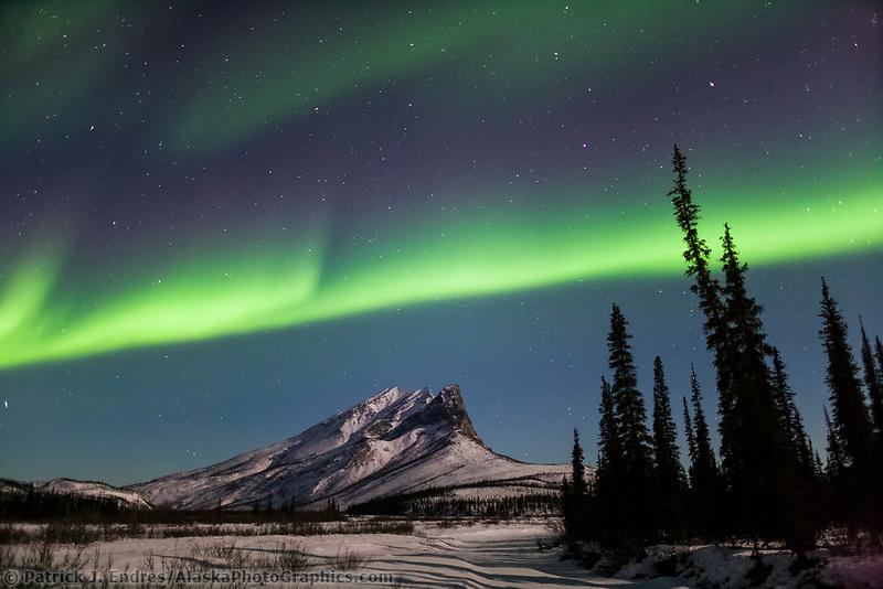 Aurora borealis over Mount Sukakpak, Brooks Range, Alaska.