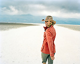 USA, California, Death Valley, woman walking at Badwater Salt Flats
