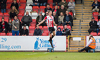 William Boyle of Cheltenham Town celebrates scoring his side's first goal during the Sky Bet League 2 match between Cheltenham Town and Grimsby Town at the The LCI Rail Stadium,  Cheltenham, England on 17 April 2017. Photo by PRiME Media Images / Mark Hawkins.