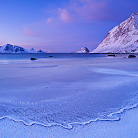 Frozen tide at Haukland beach in winter, Vestvagøy, Lofoten islands, Norway