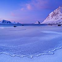 Frozen tide at Haukland beach in winter, Vestvagøy, Lofoten islands, Norway