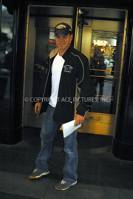 WWW.ACEPIXS.COM . . . . .  ....NEW YORK, APRIL 21, 2005....Matt Damon is seen entering an upper east side hotel. On the way in he stops for photographs and even chats up Radio Man.....Please byline: PAUL CUNNINGHAM - ACE PICTURES..... *** ***..Ace Pictures, Inc:  ..Craig Ashby (212) 243-8787..e-mail: picturedesk@acepixs.com..web: http://www.acepixs.com