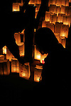 A cancer survivor shares a quiet moment with her husband in front of the luminarias presented by the American Cancer Society on the steps of the Wisconsin Capitol. They were created in remembrance of cancer victims and survivors and lit in preparation for a Relay For Life event the following evening around the Capitol Square.